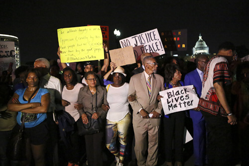Members of the U.S. House of Representatives linked arms with protesters and marched down Pennsylvania Avenue. Dan Rich | Photo Editor