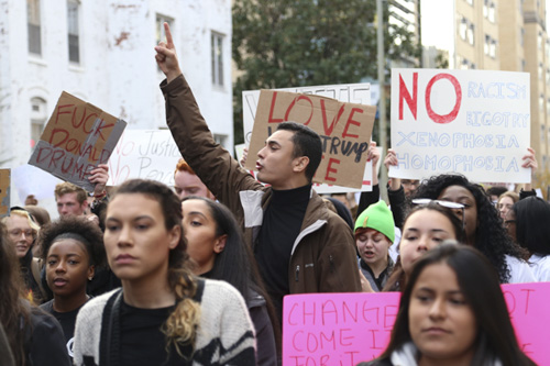 """Many supporters, including Emelio Jimenez pictured here, led the group in chants including, """"tell me what democracy looks like. This is what democracy looks like."""" Keegan Mullen   Hatchet Photographer"""