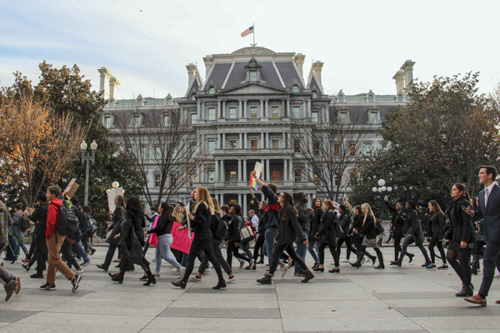 Supporters marched down Pennsylvania Avenue, in front of the Eisenhower Executive Office Building. Jack Borowiak   Hatchet Photographer