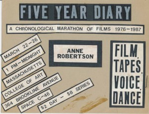 Cardboard poster with taped papers announcing time and place for film screening.