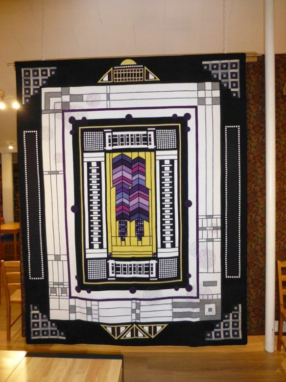 Carl Rohr's Round Robin quilt: Carl started the center with the Jackie Robinson pattern inspired by Frank Lloyd Wright's stained glass windows., and the other four men added complementary borders.