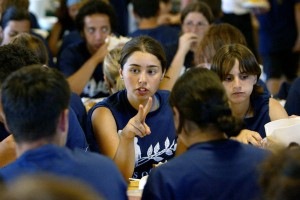 Arab-Israeli Rawan Kamal chats with tablemates during lunch at the Seeds of Peace camp in Otisfield, Maine July 10, 2002.