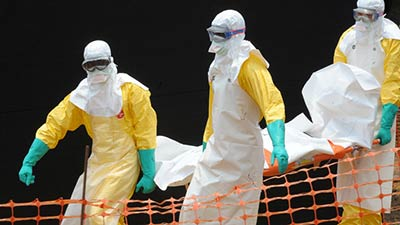 Medecins Sans Frontieres carry the corpse of person killed by Ebola AFP