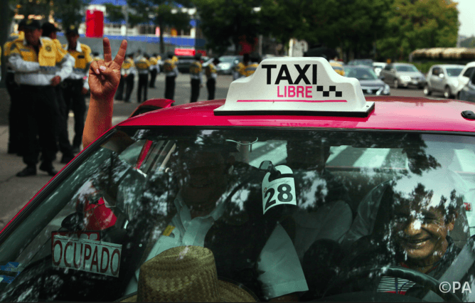 Should we love Uber and Airbnb or protest against them?