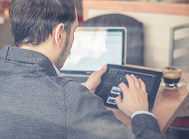Man using tablet and laptop