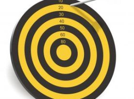 Image of dartboard with the dart almost off the edge