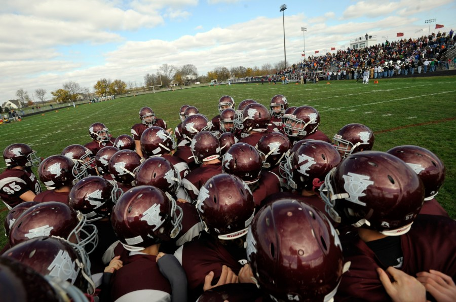 RON JOHNSON/JOURNAL STAR  IVC players huddle before taking the field against Kankakee McNamara in Saturday's first round of the IHSA Class 4A football playoffs