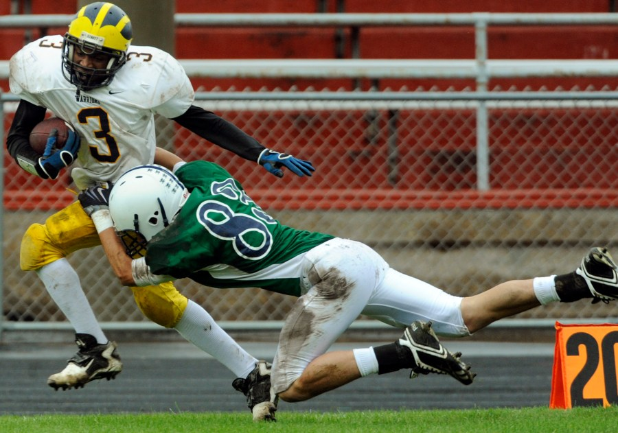 RON JOHNSON/JOURNAL STAR  John Prentiss of Notre Dame, right, tries to bring down Deontray Dorsey of Woodruff.
