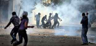 Egyptians battle security forces in protest of new president's power grab