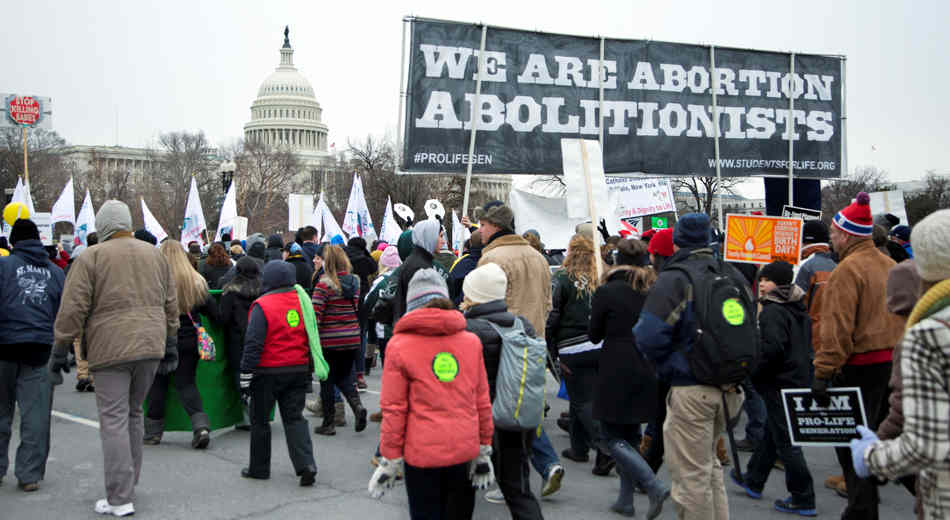 Anti-abortion demonstrators march to the U.S. Supreme Court in Washington, Friday, Jan. 25, 2013, for a rally to coincide with the 40th anniversary of the landmark Roe v. Wade decision by the U.S. Supreme Court that legalized abortion. (AP Photo/Manuel Balce Ceneta)