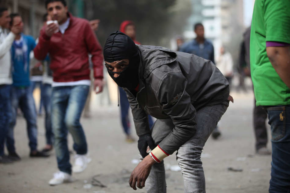 Skirmishes break out between protesters and security forces, unseen, near Tahrir Square, Cairo, Egypt, Friday, Jan. 25, 2013. Egyptian opposition protesters are gathering in Cairo's Tahrir Square to mark the second anniversary of the uprising that toppled Hosni Mubarak's autocratic regime. (AP Photo/Khalil Hamra)