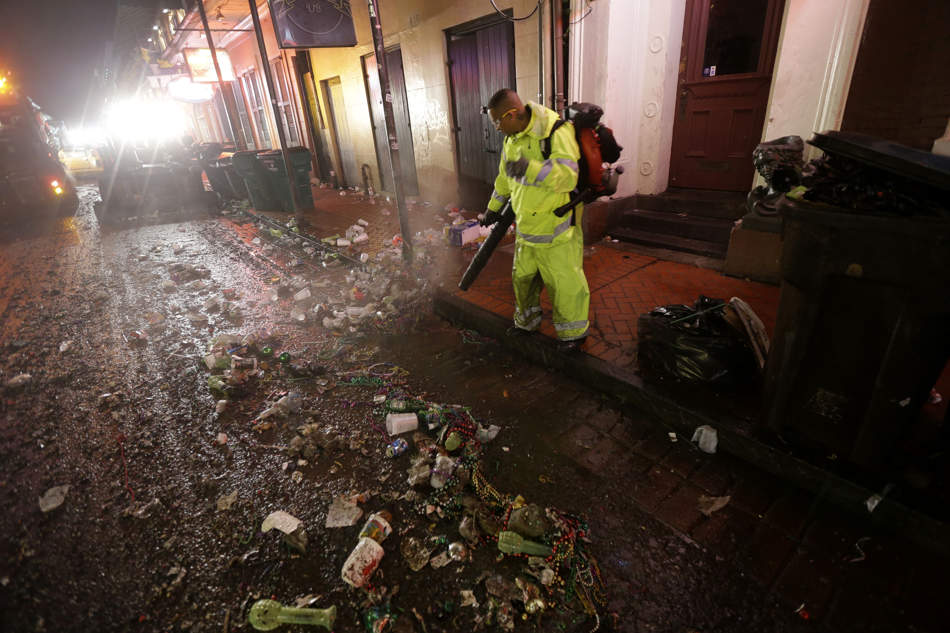 Workers clean up debris on Bourbon Street in the early morning of Ash Wednesday, the day after Mardi Gras, in the French Quarter of New Orleans, Wednesday, Feb. 13, 2013. The city has begun to clean up after Mardi Gras came to a close at midnight, with Ash Wednesday ushering in the solemn season of Lent. (AP Photo/Gerald Herbert)