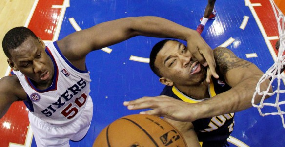 Indiana Pacers' Orlando Johnson, right, is fouled by Philadelphia 76ers' Lavoy Allen while taking a shot during the second half of an NBA basketball game, Wednesday, Feb. 6, 2013, in Philadelphia. Indiana won 88-69. (AP Photo/Matt Slocum)