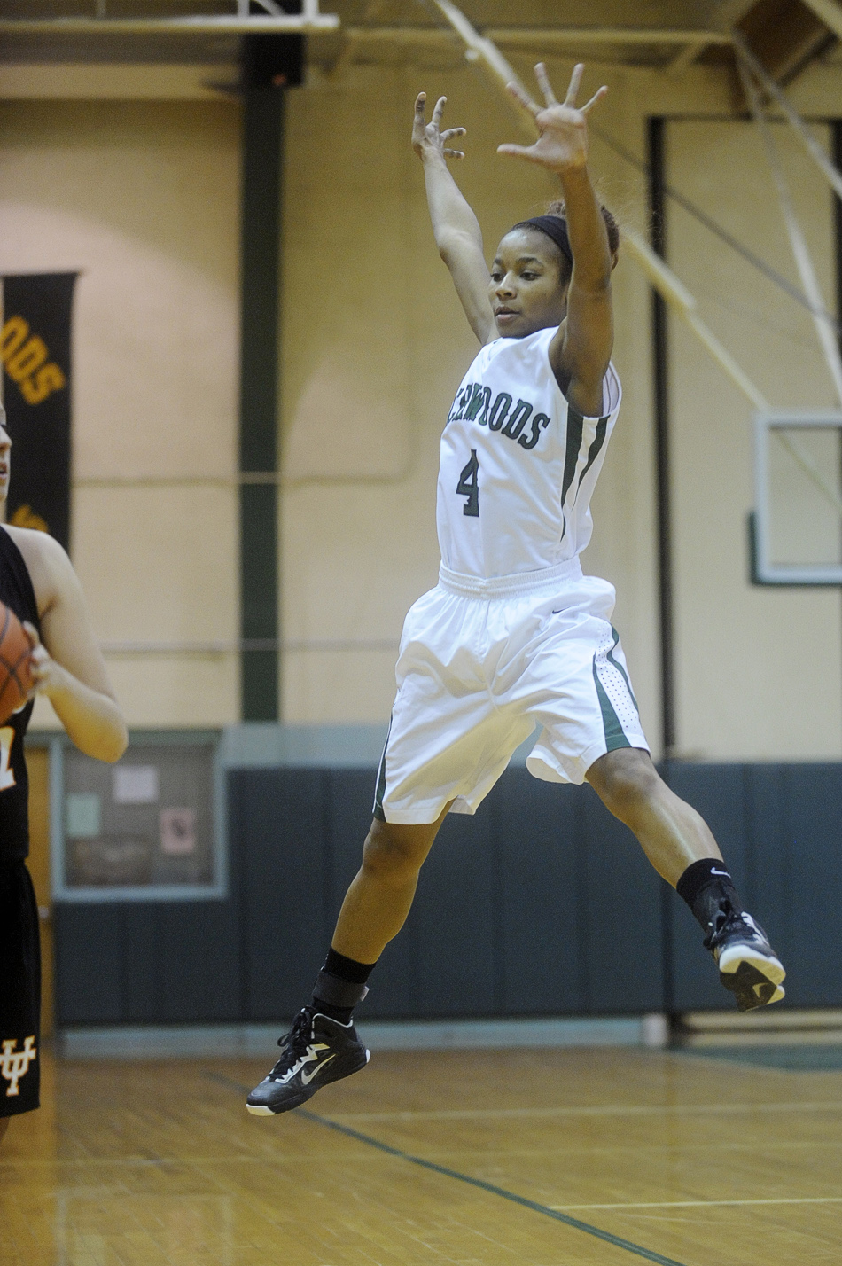 NICK SCHNELLE/JOURNAL STAR  LaDaisha Yates (4) of Richwoods  jumps in the air to block a pass during the game against United Township on Friday at a Class 4A Regional Championship game at Richwoods High School. Richwoods defeated United Township 57-42.
