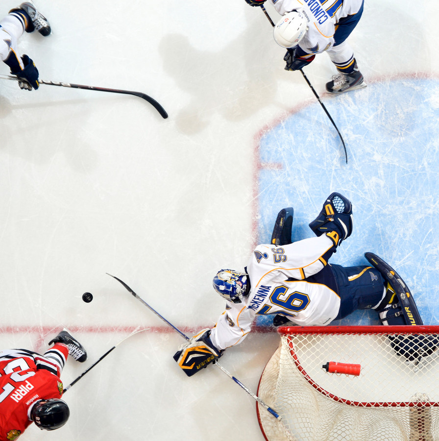 RON JOHNSON/JOURNAL STAR  A view from above shows goaltender Mike McKenna of the Rivermen as tries to stop a shot at the goal during Wednesday 's AHL game with the Roickford Icehogs at Carver Arena. The Rivermen lost, 4-0.