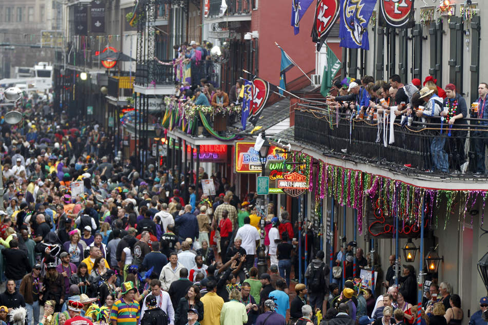 Crowds of revelers are seen on Bourbon Street from the balcony of the Royal Sonesta Hotel during Mardi Gras in New Orleans, Tuesday, Feb. 12, 2013. (AP Photo/Gerald Herbert)
