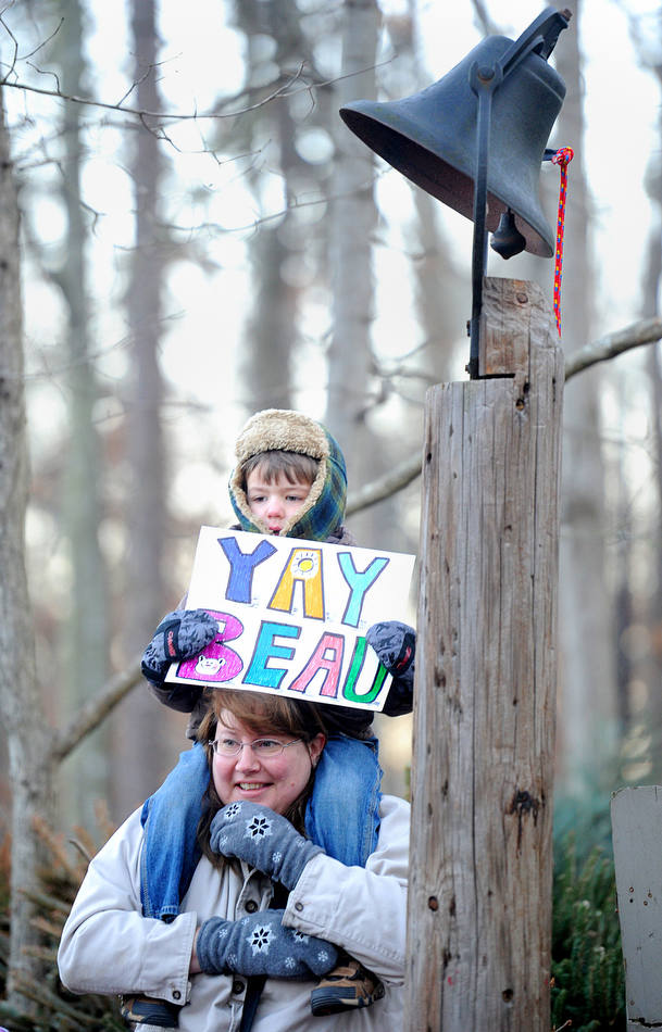 Eli Stone, 4, and his mother Valerie Stone watch groundhog Gen. Beauregard Lee show himself at sunrise on Groundhog Day at the Yellow River Game Ranch in Lilburn, Ga. on Saturday, Feb. 2, 2013. His shadow was seen and according to this folklore tradition the annual weather prediction is six more weeks of winter. (AP Photo/Gwinnett Daily Post, Brendan Sullivan)  MANDATORY CREDIT