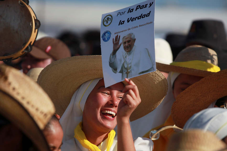 FILE - In this Sunday, March 25, 2012 file photo, pilgrims cheer and sing as they wait at the site where Pope Benedict XVI will give a Mass in Bicentennial Park near Silao, Mexico. Pope Benedict XVI announced Monday, Feb. 11, 2013, he would resign Feb. 28 because he is simply too old to carry on. (AP Photo/Dario Lopez-Mills, File)