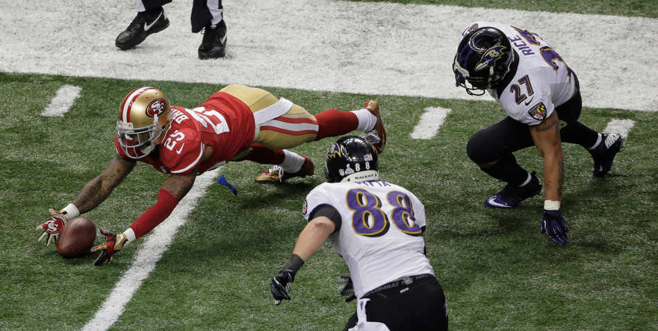 San Francisco 49ers cornerback Tarell Brown (25) recovers a fumble by Baltimore Ravens running back Ray Rice (27) as tight end Dennis Pitta (88) closes in during the second half of the NFL Super Bowl XLVII football game, Sunday, Feb. 3, 2013, in New Orleans. (AP Photo/Charlie Riedel)