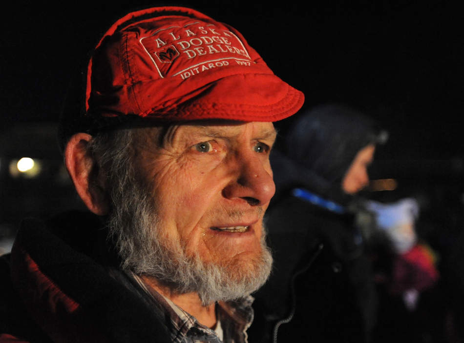 Dan Seavey waits to see his son Mitch Seavey became a two-time Iditarod champion on Tuesday evening March 12, 2013.  (AP Photo/The Anchorage Daily News, Bill Roth)  LOCAL TV OUT (KTUU-TV, KTVA-TV) LOCAL PRINT OUT (THE ANCHORAGE PRESS, THE ALASKA DISPATCH)