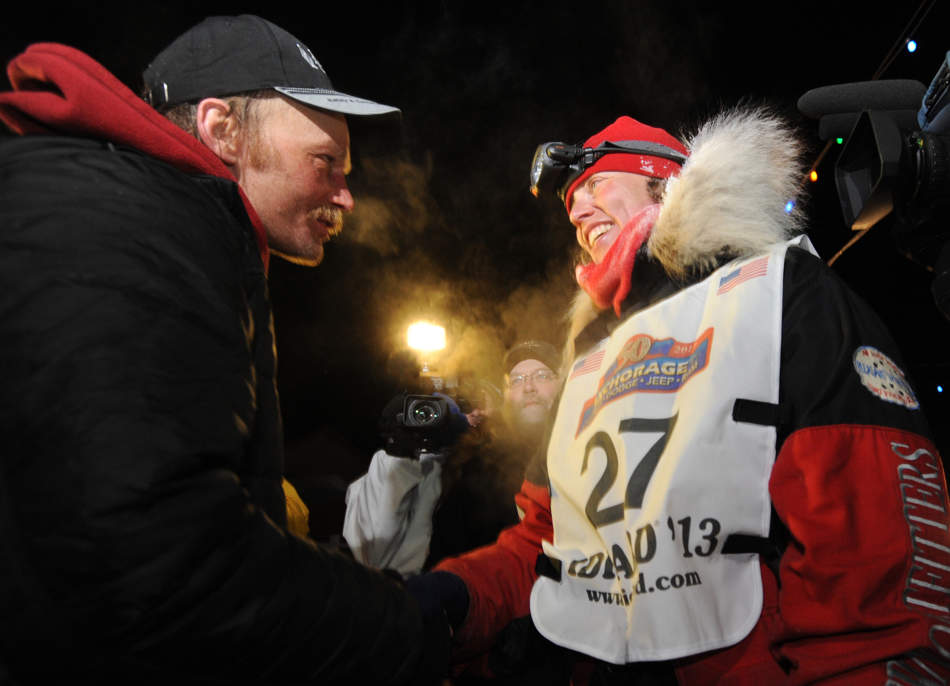 Mitch Seavey became the oldest winner and a two-time Iditarod champion when he drove his dog team under the burled arch in Nome on Tuesday evening, March 12, 2013.  He congratulates second place finisher Aliy Zirkle after she arrived in Nome. (AP Photo/The Anchorage Daily News, Bill Roth)  LOCAL TV OUT (KTUU-TV, KTVA-TV) LOCAL PRINT OUT (THE ANCHORAGE PRESS, THE ALASKA DISPATCH)