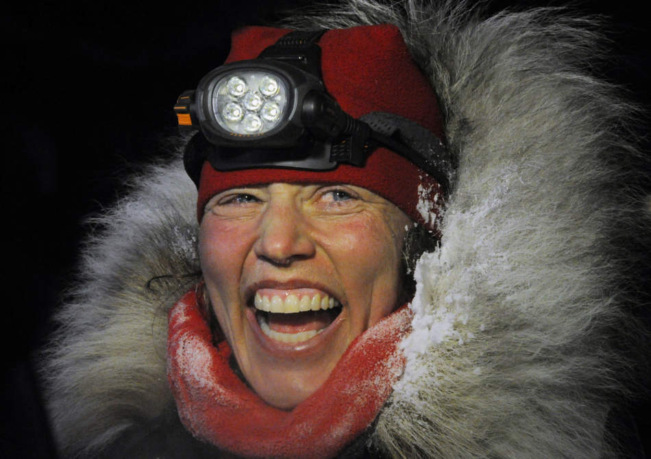 Aliy Zirkle finished second in the Iditarod for the second consecutive year when her dog team crossed under the burled arch in Nome on Tuesday evening, March 12, 2013. (AP Photo/The Anchorage Daily News, Bill Roth)  LOCAL TV OUT (KTUU-TV, KTVA-TV) LOCAL PRINT OUT (THE ANCHORAGE PRESS, THE ALASKA DISPATCH)