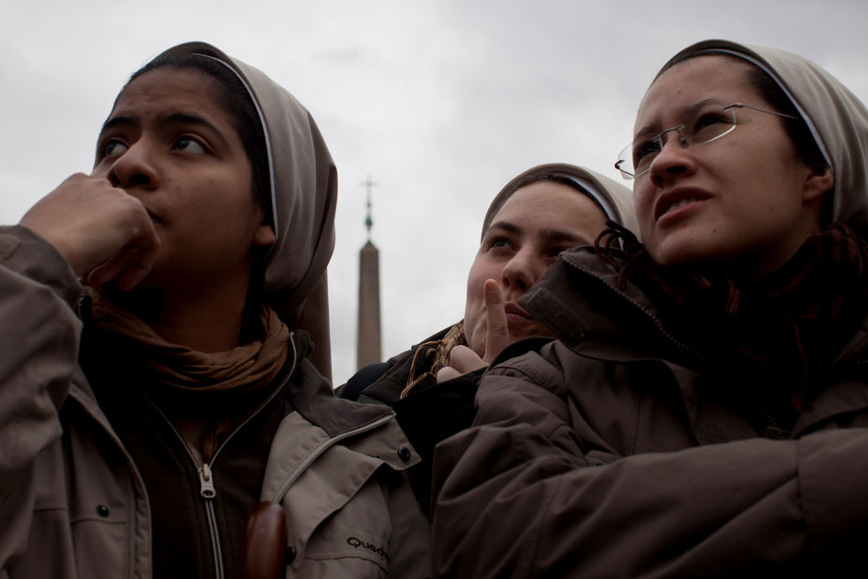 Nuns wait for the chimney smoke in St. Peter's Square during the second day of the conclave to elect a new pope, at the Vatican, Wednesday, March 13, 2013. Black smoke again billowed from the chimney of the Sistine Chapel on Wednesday, meaning that Catholic cardinals hadn't elected a pope on their second or third rounds of balloting. (AP Photo/Oded Balilty)
