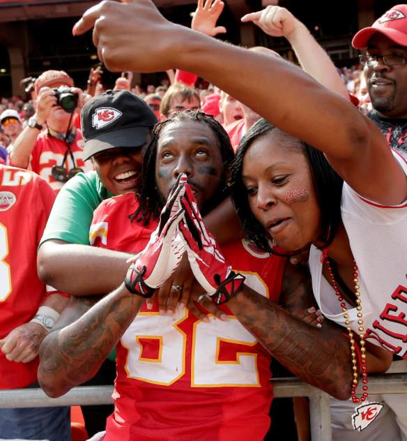 Kansas City Chiefs wide receiver Dwayne Bowe (82) celebrates with fans after 17-16 win over the Dallas Cowboys in an NFL football game  Sunday, Sept. 15, 2013, in Kansas City, Mo.  (AP Photo/Charlie Riedel)