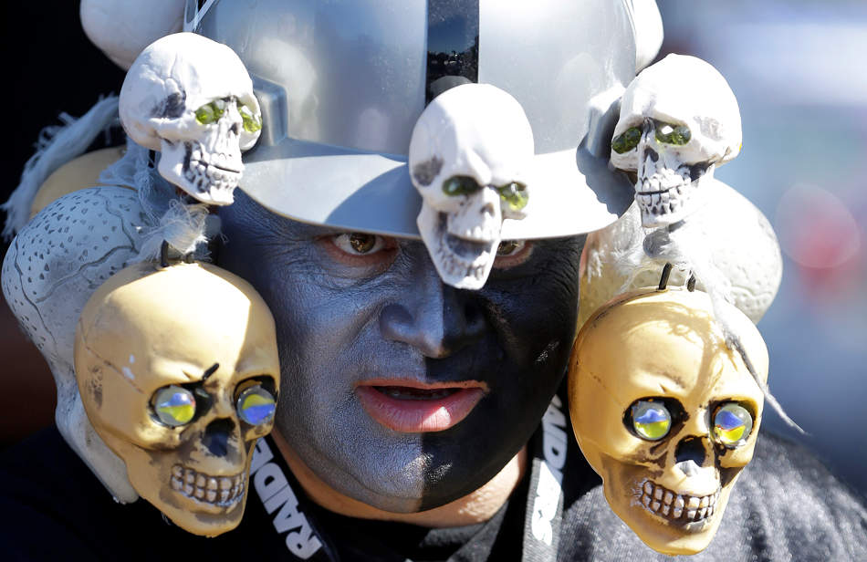 Oakland Raiders fan Douglas Guillen stands in the O.co Coliseum parking lot before an NFL football game between the Oakland Raiders and the Jacksonville Jaguars in Oakland, Calif., Sunday, Sept. 15, 2013. (AP Photo/Ben Margot)