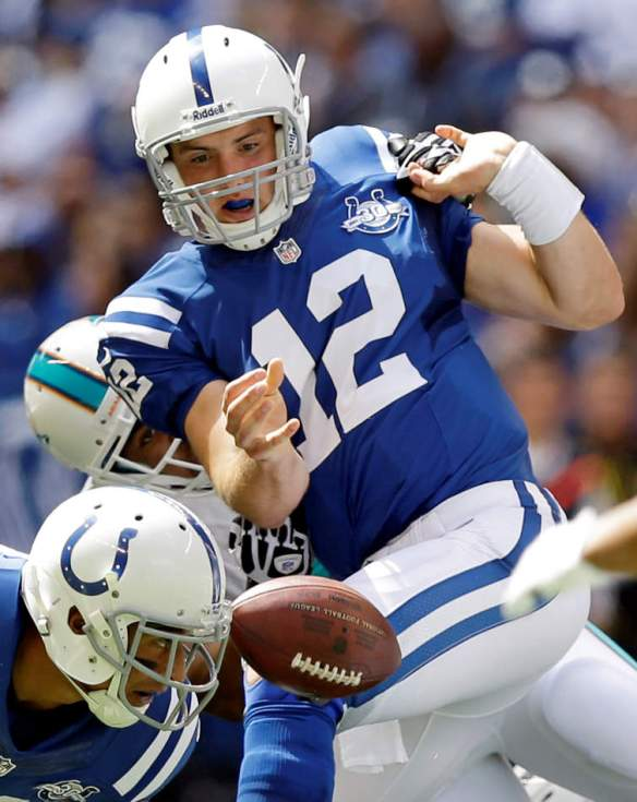Indianapolis Colts' Andrew Luck (12) is sacked by Miami Dolphins' Derrick Shelby during the first half an NFL football game on Sunday, Sept. 15, 2013, in Indianapolis. (AP Photo/Michael Conroy)