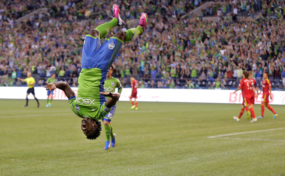 Seattle Sounders' Obafemi Martins does a flip to celebrate after scoring a goal against Real Salt Lake in the first half of an MLS soccer match, Friday, Sept. 13, 2013, in Seattle. (AP Photo/Ted S. Warren)