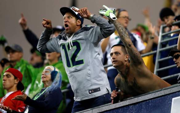 Seattle Seahawks' fans yell from the stands  in Century Link Field during an NFL football game against the San Francisco 49ers, Sunday, Sept. 15, 2013, in Seattle. A new Guinness World Record for loudest crowd roar at a sports stadium was set during the game. (AP Photo/John Froschauer)