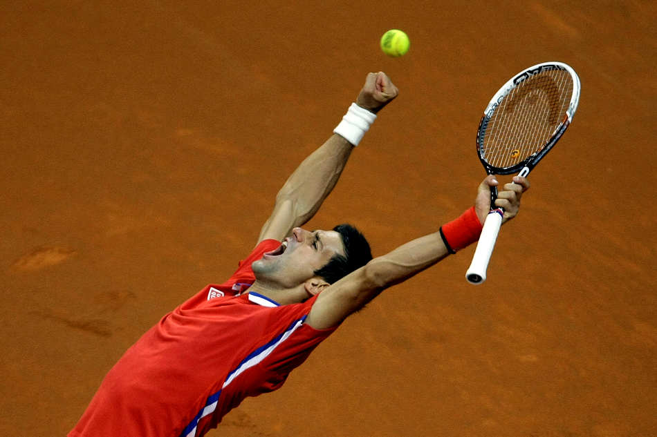 Serbia's Novak Djokovic celebrates after winning the Davis Cup semifinals tennis match against Canada's Milos Raonic in Belgrade, Serbia, Sunday, Sept. 15, 2013. (AP Photo/ Marko Drobnjakovic)