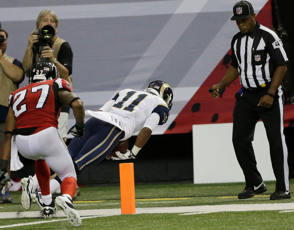 St. Louis Rams wide receiver Tavon Austin (11) makes a touch-down catch against Atlanta Falcons cornerback Robert McClain (27) looks on as well as official Boris Cheek during the second half of an NFL football game, Sunday, Sept. 15, 2013, in Atlanta. (AP Photo/John Bazemore)