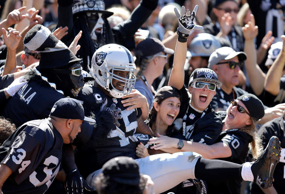 Oakland Raiders fullback Marcel Reece (45) celebrates with fans after scoring on an 11-yard touchdown run during the first quarter of an NFL football game against the Jacksonville Jaguars, Sunday, Sept. 15, 2013, in Oakland, Calif. (AP Photo/Ben Margot)