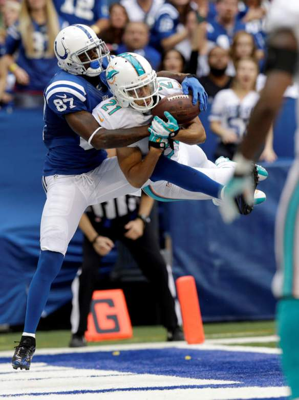 Miami Dolphins' Brent Grimes (21) intercepts a pass in the end zone intended for Indianapolis Colts' Reggie Wayne (87) during the second half an NFL football game Sunday, Sept. 15, 2013, in Indianapolis. (AP Photo/AJ Mast)(AP Photo/Michael Conroy)
