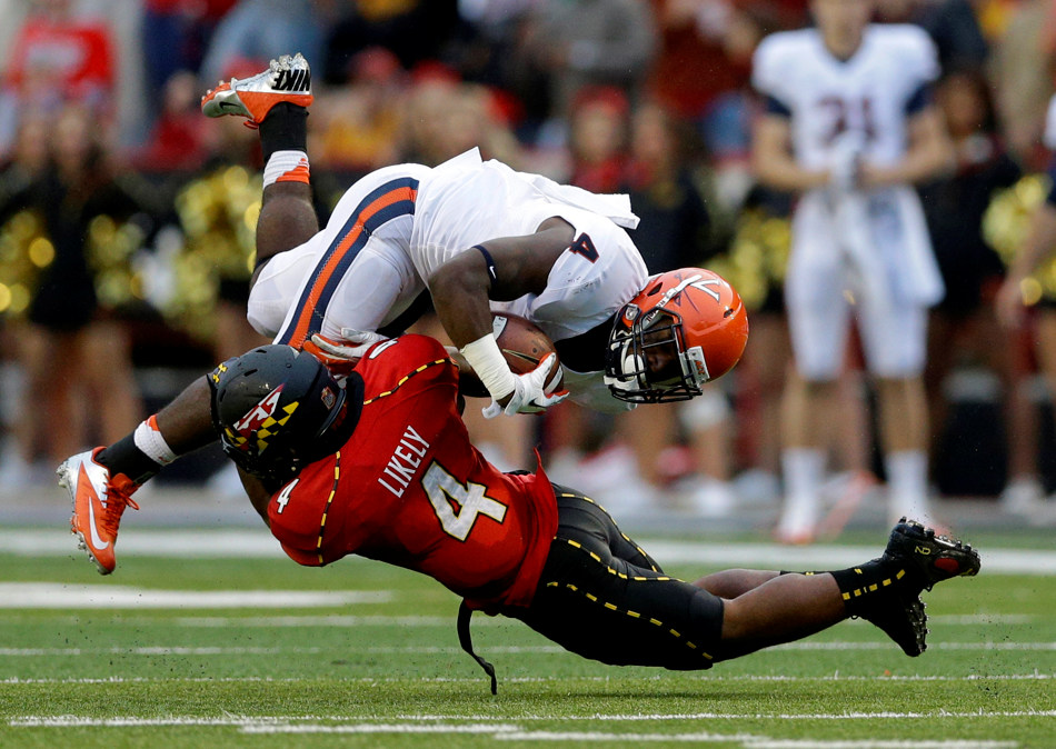 Virginia running back Taquan Mizzell, top, is stopped by Maryland defensive back William Likely in the second half of an NCAA college football game in College Park, Md., Saturday, Oct. 12, 2013. Maryland won 27-26. (AP Photo/Patrick Semansky)