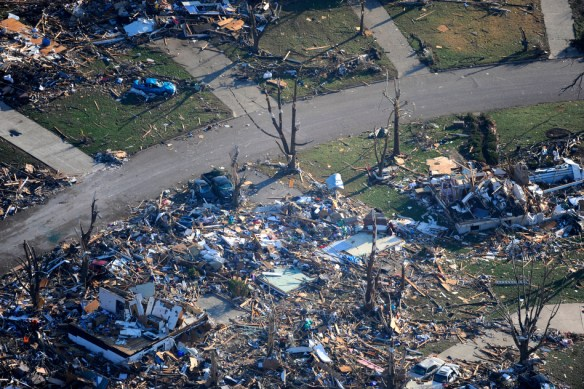 FRED ZWICKY/JOURNAL STAR The path of destruction as seen from the air after a tornado ripped through Washington, killing one person, injuring dozens more and decimated hundreds of homes as a storm system moved through Pekin, East Peoria and Washington.