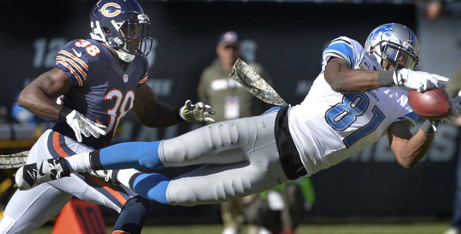 RON JOHNSON/JOURNAL STAR  Lions receiver Calvin Johnson grabs this reception in front of Bears cornerback Zachary Bowman during Sunday's game at Soldier Field. Johnson had to touchdown receptions on the day to help the Lions win,  21-19 over the Bears.