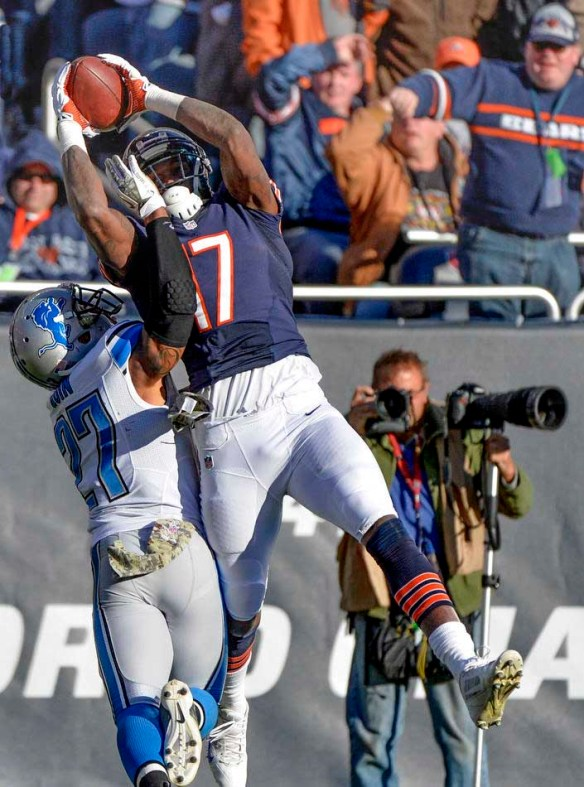 RON JOHNSON/JOURNAL STAR  Bears receiver Alshon Jeffrey grabs this reception in the end zone over Lions safety Glover Quinn, but failed to score in Sunday's 21-19 loss.
