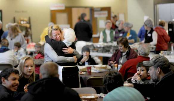 DAVID ZALAZNIK/JOURNAL STAR  Laurie Estenson, left, of Washington tearfully encounters lifelong friend Linnie McCulley on Nov. 20 at the relief station at Crossroads Church in Washington where McCulley was serving food for tornado victims and volunteers.