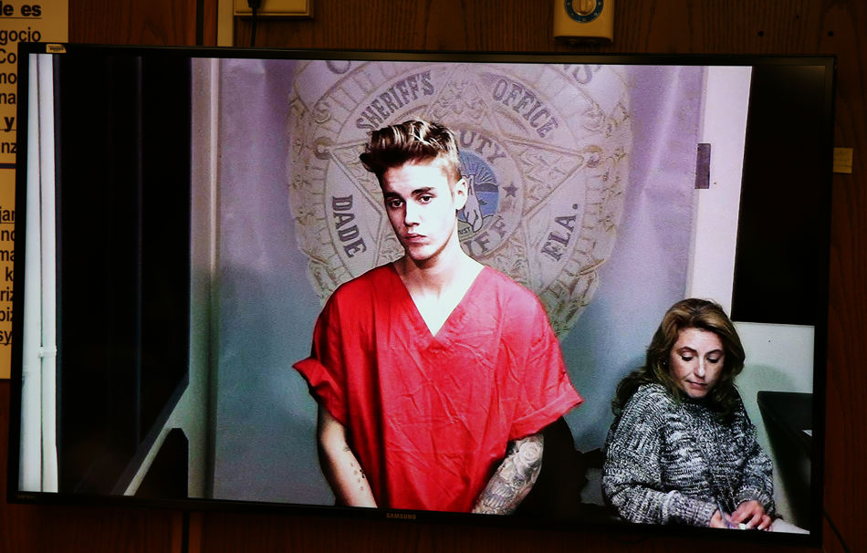 Justin Bieber appears in court via video feed, Thursday, Jan. 23, 2014, in Miami. Bieber was released from jail Thursday following his arrest on charges of driving under the influence, driving with an expired license and resisting arrest. Police say they stopped the 19-year-old pop star while he was drag-racing down a Miami Beach street before dawn. (AP Photo/The Miami Herald, Walter Michot, Pool)