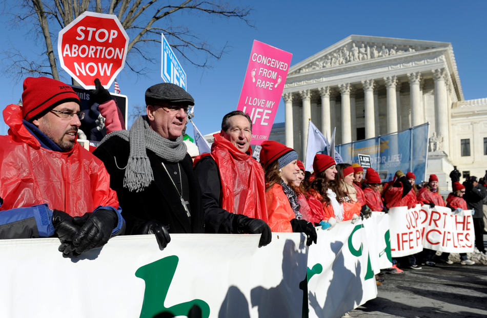 Protestor lead the annual March for Life Rally near the Supreme Court in Washington, Wednesday, Jan. 22, 2014. Thousands of abortion opponents are facing wind chills in the single digits to rally and march on Capitol Hill to protest legalized abortion, with a signal of support from Pope Francis. (AP Photo/Susan Walsh)