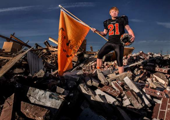 FRED ZWICKY/JOURNAL STAR Casey Danley of Washington may have set the school's single-season rushing mark, but he says the more important task was to support the community after an EF-4 tornado destroyed 1,000 homes the week before their state semifinal game. The football team spent two days helping residents dig out before they could get back to the business of preparing a game that rallied the community. Casey's home was largely untouched, but ten of his teammates weren't so fortunate.