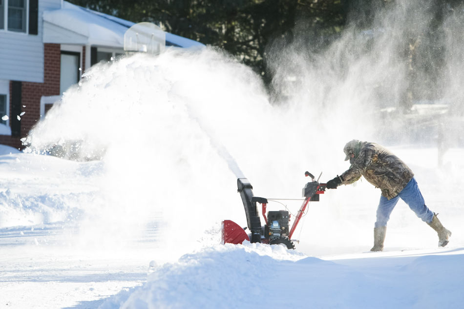 Everet Sapp digs out from the pile of snow in Hockessin, Del., on Wednesday, Jan. 22, 2014.  The Northeast started to clean up from a winter storm that swirled up the coast Tuesday.  (AP Photo/The Wilmington News-Journal, Suchat Pederson)  NO SALES