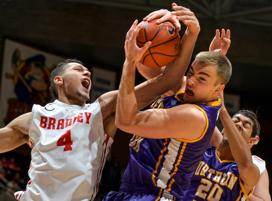 RON JOHNSON/JOURNAL STAR   Bradley's Auston Barnes, left, and UNI's Chip Rank wrestle for a rebound during a game on January 22 at Carver Arena in Peoria.
