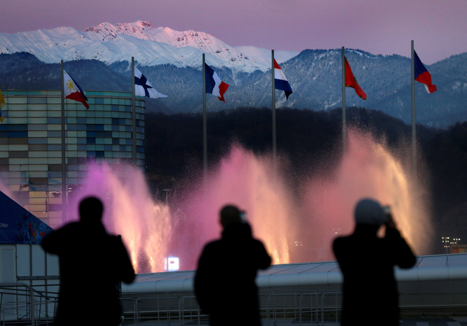 Spectators photograph water fountains at Olympic Park during final preparations before the 2014 Winter Olympics, Monday, Feb. 3, 2014, in Sochi, Russia. (AP Photo/Robert F. Bukaty)