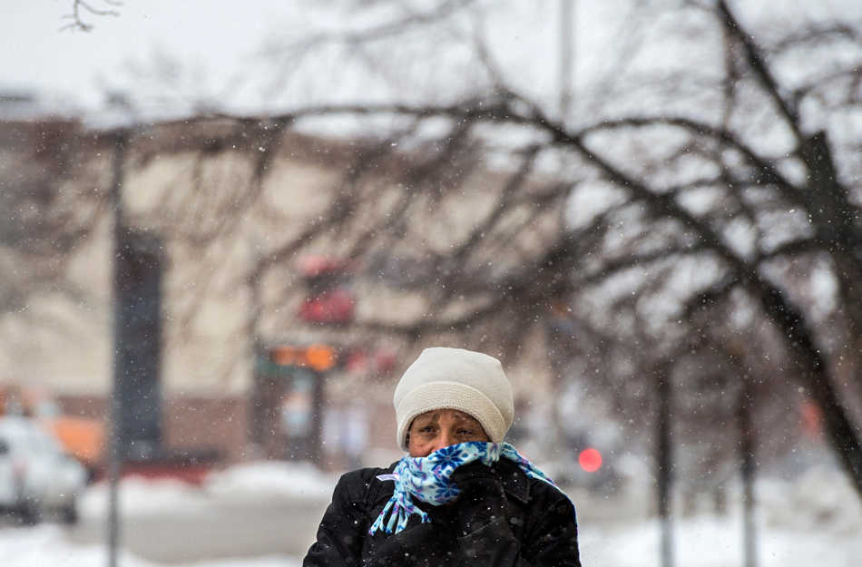 FRED ZWICKY/JOURNAL STAR Mildred Sanders-Baldon says she braves the cold every day on her walk through Downtown Peoria on Feb. 4.
