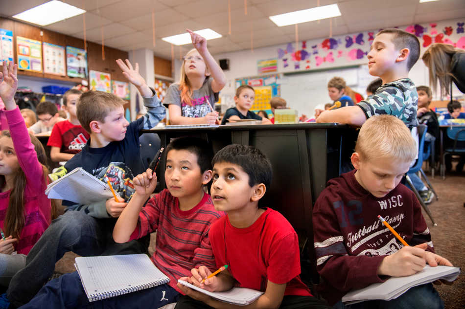 FRED ZWICKY/JOURNAL STAR It's a full house in Beth Schlueter's third grade class at Banner Elementary School as her 29 students work through math problems. Unable to see from the back of the crowded room, several students moved up to the front to see the board better. From right, Dylan Stejskal, Shan Patel, Vincent Wu, and Joshua Jackson work on a fraction worksheet.