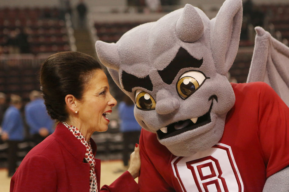 KRISTEN ZEIS/JOURNAL STAR Bradley President Joanne Glasser whispers into the ear of new Bradley mascot, Kaboom! on Saturday.